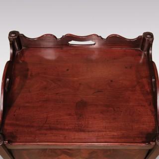 A George III period mahogany bedside cupboard