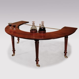 A Regency period Gillows horse shoe or wine table