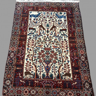 A FINE SAROUK RUG SIGNED AND DATED