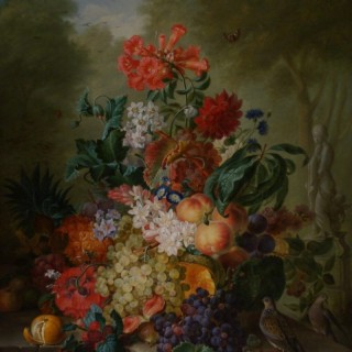 A Still Life of an abundance of Fruits and Flowers on a ledge