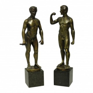 A PAIR OF SPIRO SCHWATENBERG BRONZE MALE NUDES