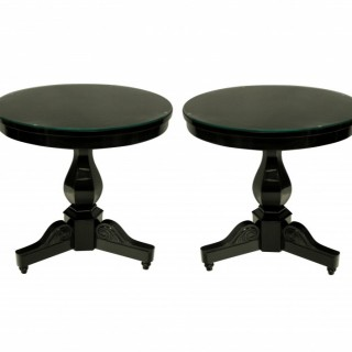 A PAIR OF FRENCH EBONISED GUERIDON TABLES