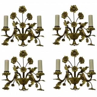 A SET OF FOUR FRENCH GILT BRONZE FLOWER SCONCES
