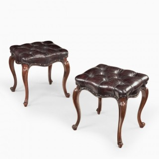 A pair of mid-Victorian rosewood stools