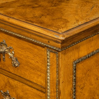 A fine George IV burr oak chest of drawers in the manner of Morel and Seddon
