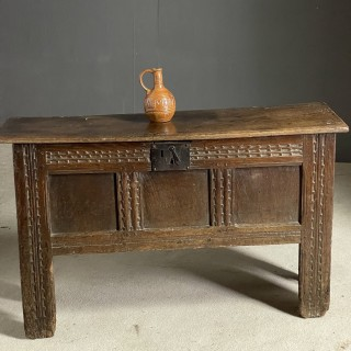 Mid 17th C plank panelled coffer well carved
