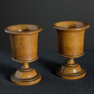 A pair of vase shaped turned cups, late 19th Century