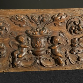 A late 17th Century Carved Oak Panel