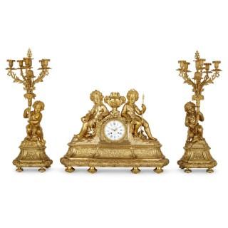 Antique Neoclassical style three-piece gilt bronze clock set