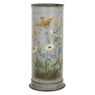 Rustic metal umbrella stand with painted flower decoration