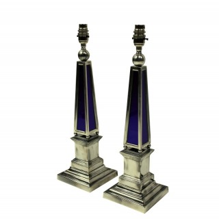 A PAIR OF SILVER OBELISK LAMPS WITH BRISTOL BLUE GLASS PANELS