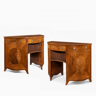 A fine pair of George III figured mahogany side cabinets, in the manner of Thomas Sheraton