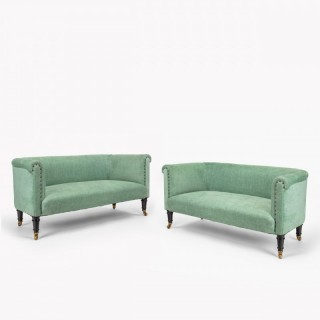 A pair of small Victorian window sofas