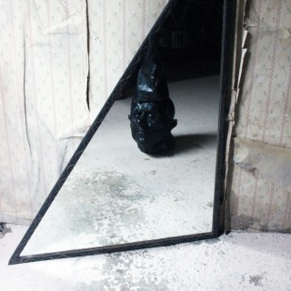 An Unusual Mid-Century French Iron Framed Triangular Wall Mirror c.1940
