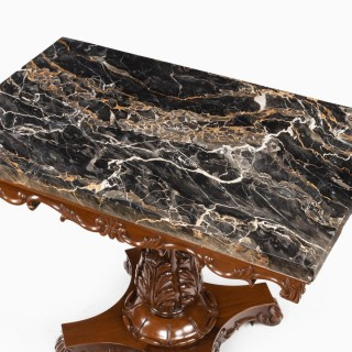 An Anglo-Indian mahogany table with Nero portoro marble top by White and Co Calcutta