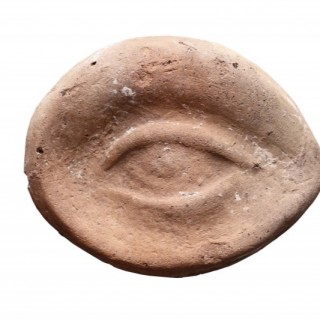 An Ancient Etruscan Terracotta Votive Model of an Eye