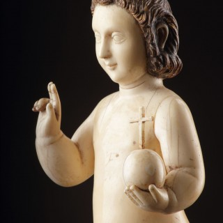 An Indo-Portuguese Goa Finely Carved Ivory Figure of the Infant Christ as Saviour of the World 'Salvator Mundi'