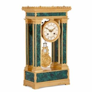 Neoclassical French Empire period malachite and gilt bronze mantel clock