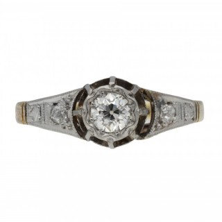 Antique diamond flanked solitaire ring, circa 1915.