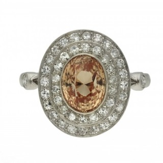 Padparadscha sapphire and diamond coronet cluster ring, circa 1915.