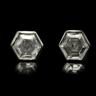 Vintage hexagonal diamond stud earrings, circa 1970.
