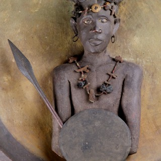 Madagascan Southern Sakalava Peoples Plaque Depicting a Warrior