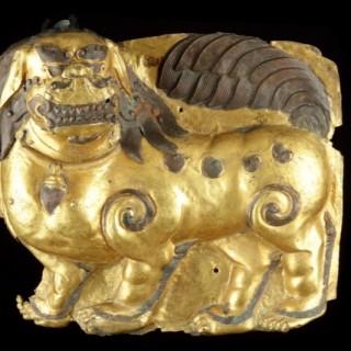 Tibetan Gilt Copper Repoussé Panel Depicting a Standing Snow Lion