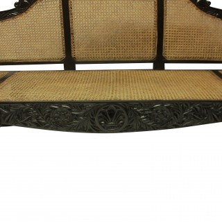 A LARGE ANGLO-CEYLONESE SETTEE IN SOLID EBONY