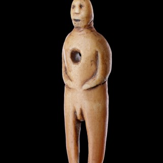 A carved walrus ivory Bering Strait Inuit shaman's amulet in form of a man