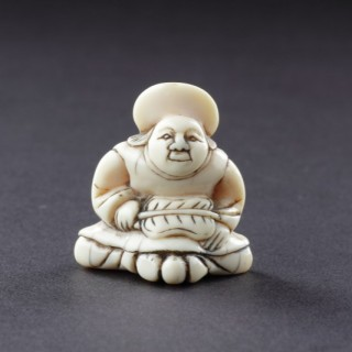 Japanese Ivory Netsuke of a Dutchman Wearing a Broad Rimmed Hat
