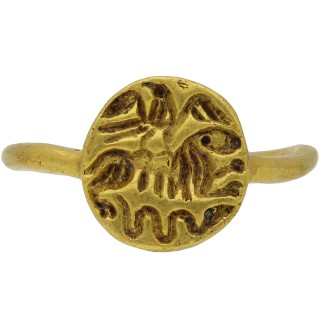 Medieval gold intaglio ring with eagle, lion and serpent, circa 6th - 9th century AD.