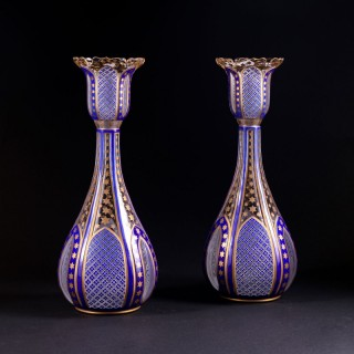 A pair of Napoleon III cut and cased glass vases in the moorish taste.