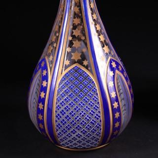 A pair of Napoleon III cut and cased glass vases in the moorish taste.