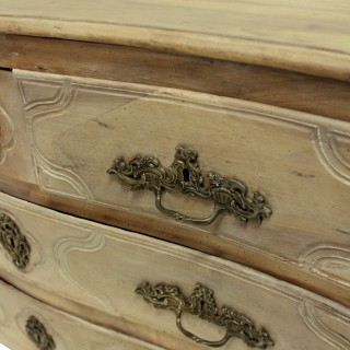 A PICKLED LOUIS XV WALNUT COMMODE