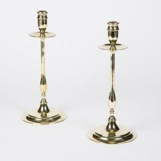 A pair of brass candlesticks, circa 1900.
