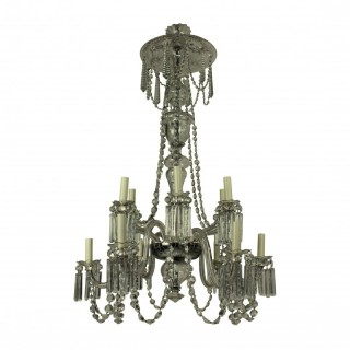 AN EDWARDIAN CUT GLASS TWELVE LIGHT CHANDELIER