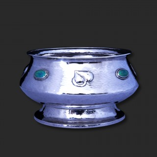 A large A E Jones art nouveau silver bowl set with Ruskin stones