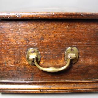 A GEORGE III OAK TRAVELING DESK BOX CIRCA 1760