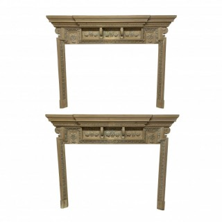 A PAIR OF LARGE ENGLISH XVIII CENTURY PICKLED FIRE SURROUNDS