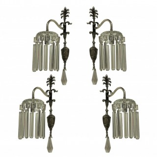 A SET OF FOUR SILVER PLATED & CUT GLASS EDWARDIAN WALL LIGHTS