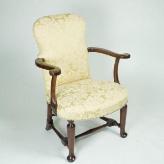George II Walnut upholstered Arm Chair
