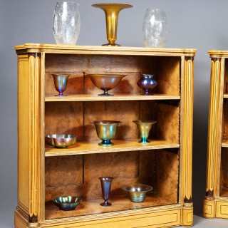A pair of painted open bookcases