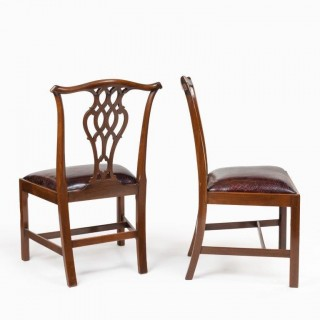 An extensive set of 34 mahogany chairs by Charles Baker, comprising four carvers and 30 side chairs