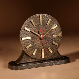 A Very Stylish Amsterdam School Hammered Patinated Brass Early Electrical Mantel Clock.