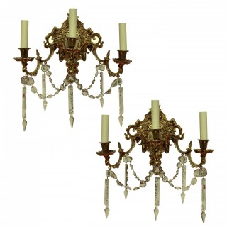 A PAIR OF FRENCH GILT BRONZE & CUT GLASS WALL LIGHTS