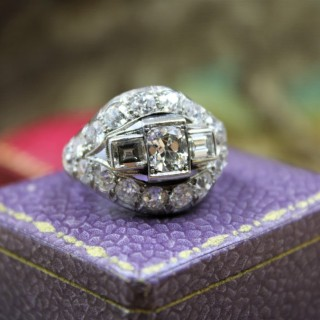 A very fine Art Deco Diamond Demi-Bombé Ring mounted in Platinum, French, Circa 1930