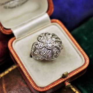 An Art Deco Diamond Demi-Bombé Ring mounted in Platinum, Circa 1935