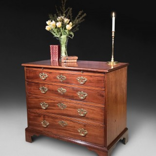 George III mahogany and rosewood crossbanded chest of drawers