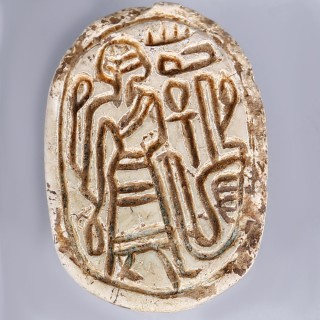 Egyptian Hyksos Period Steatite Scarab with Male Figure