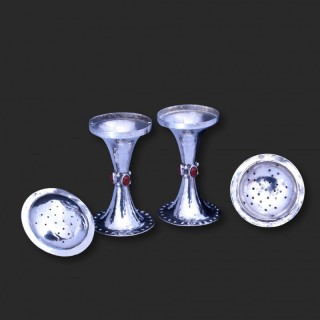 A pair of Charles Ashbee for Marcus and Co marts and crafts silver peppers